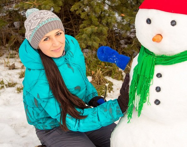 Snow man and a Russian girl.