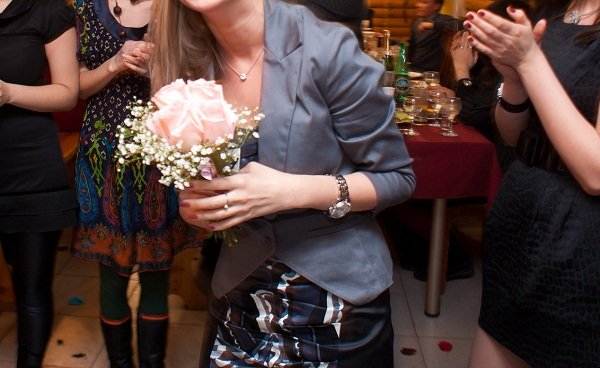 Russian bride throws her flower bouquet.